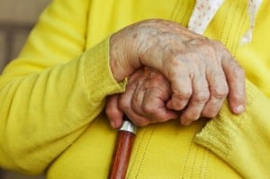 Elderly Woman Holding A Cane Stock Photo