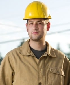 Male Construction Worker In A Yellow Hard Hat Stock Photo