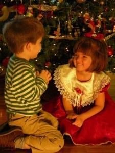 Two children at the Christmas tree
