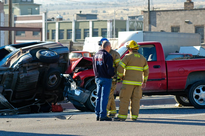 First Responders Addressing Auto Accident Stock Photo