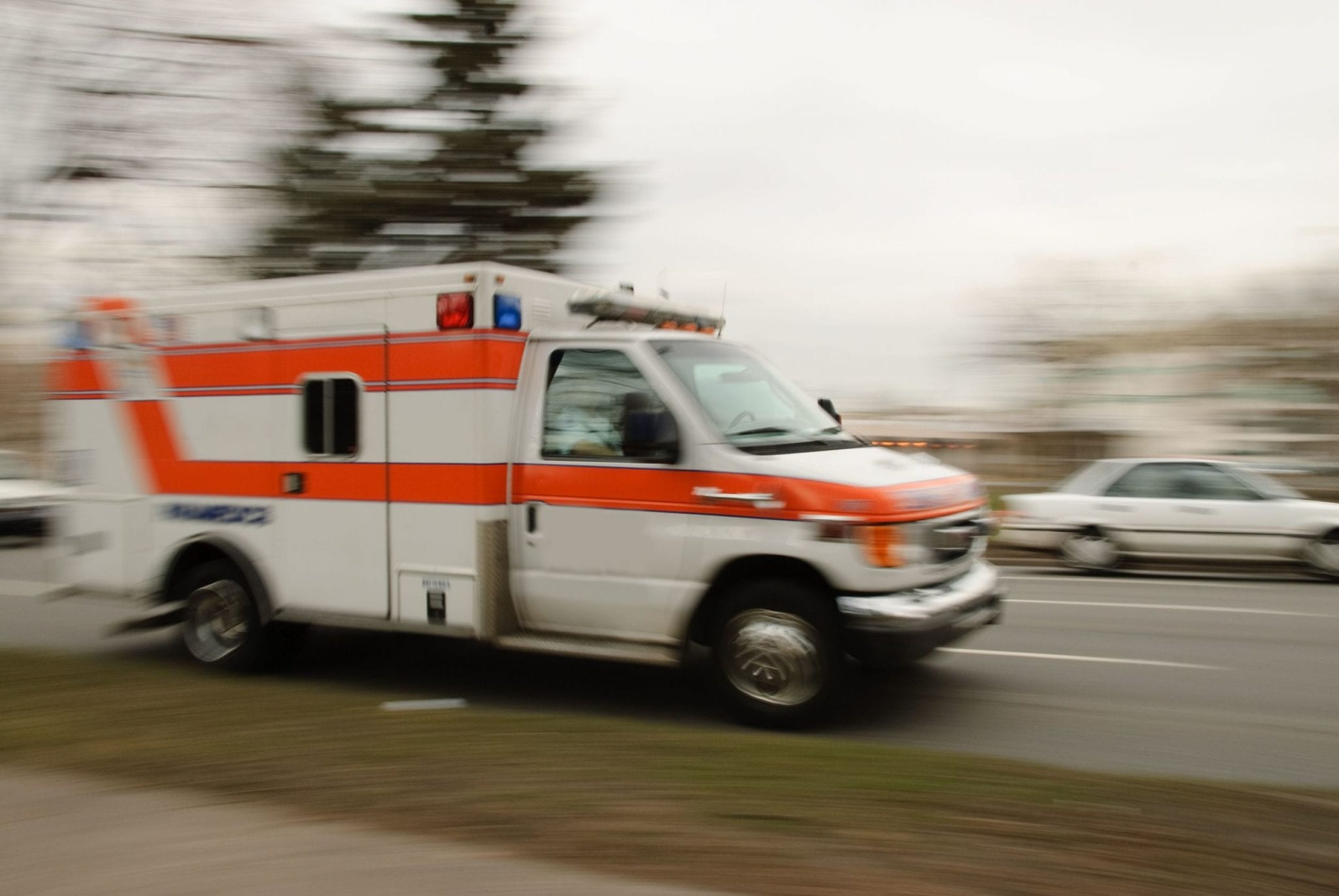 Ambulance Responding To An Accident Stock Photo