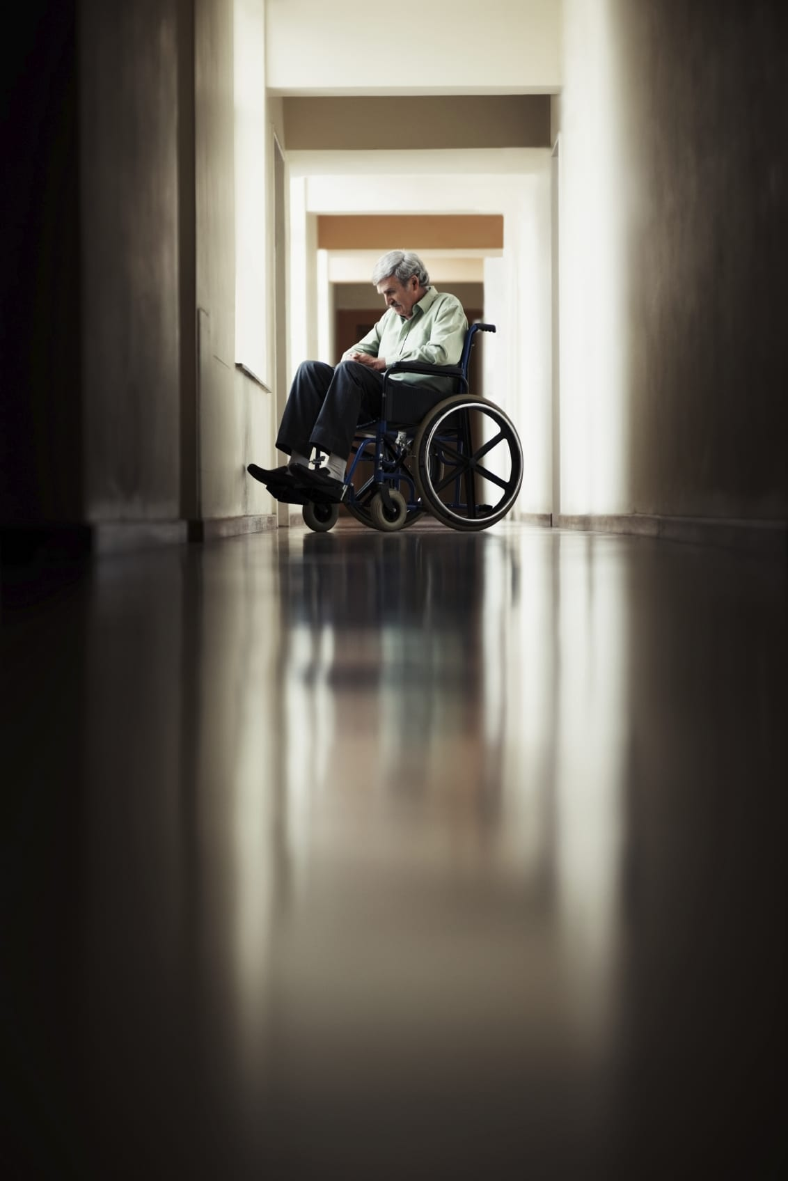 Elderly Man Sitting In A Wheelchair Stock Photo