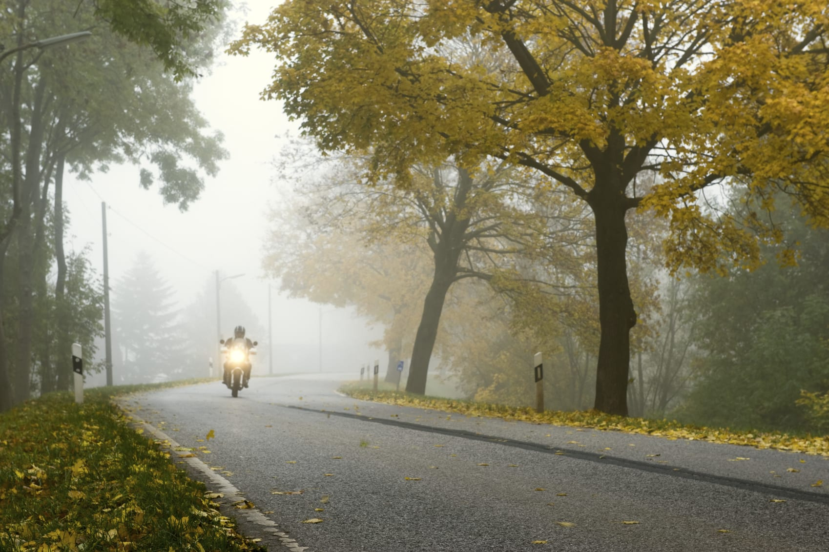 Motorcyclist Riding Motorcycle On A Beautiful Rural Road