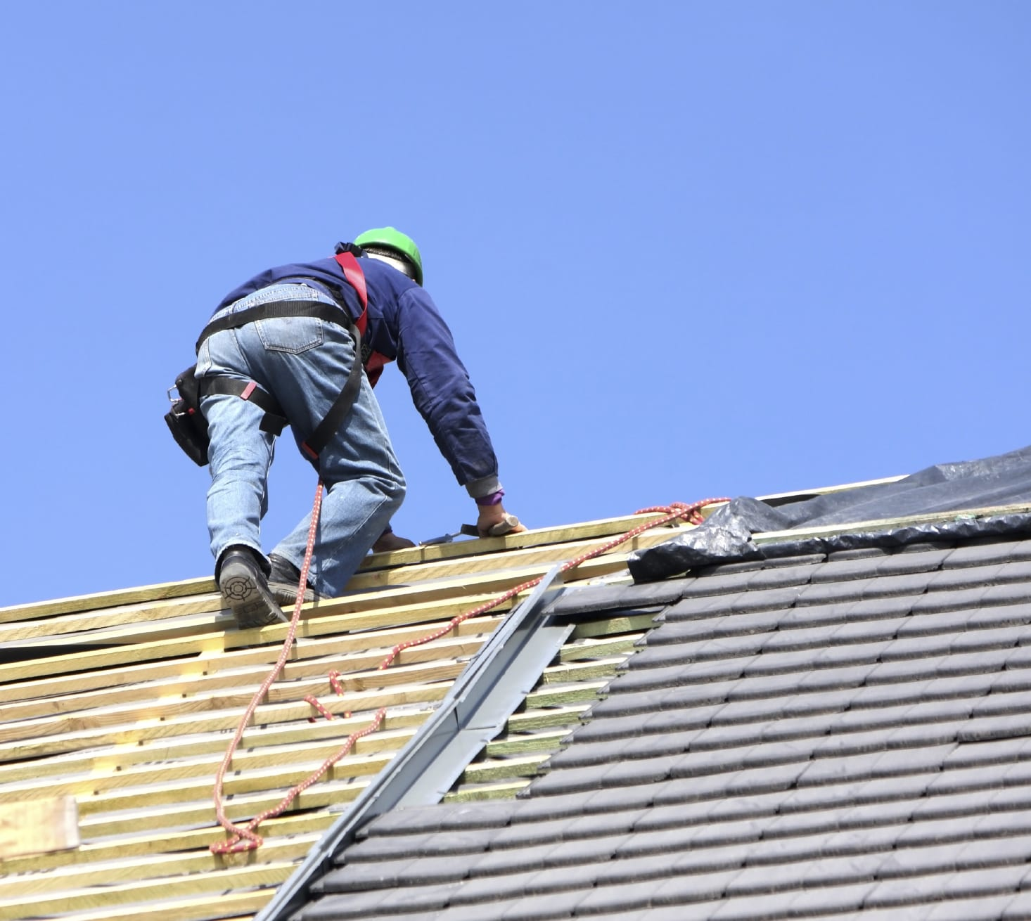 Roofer Repairing The Roof Of A Home Stock Photo