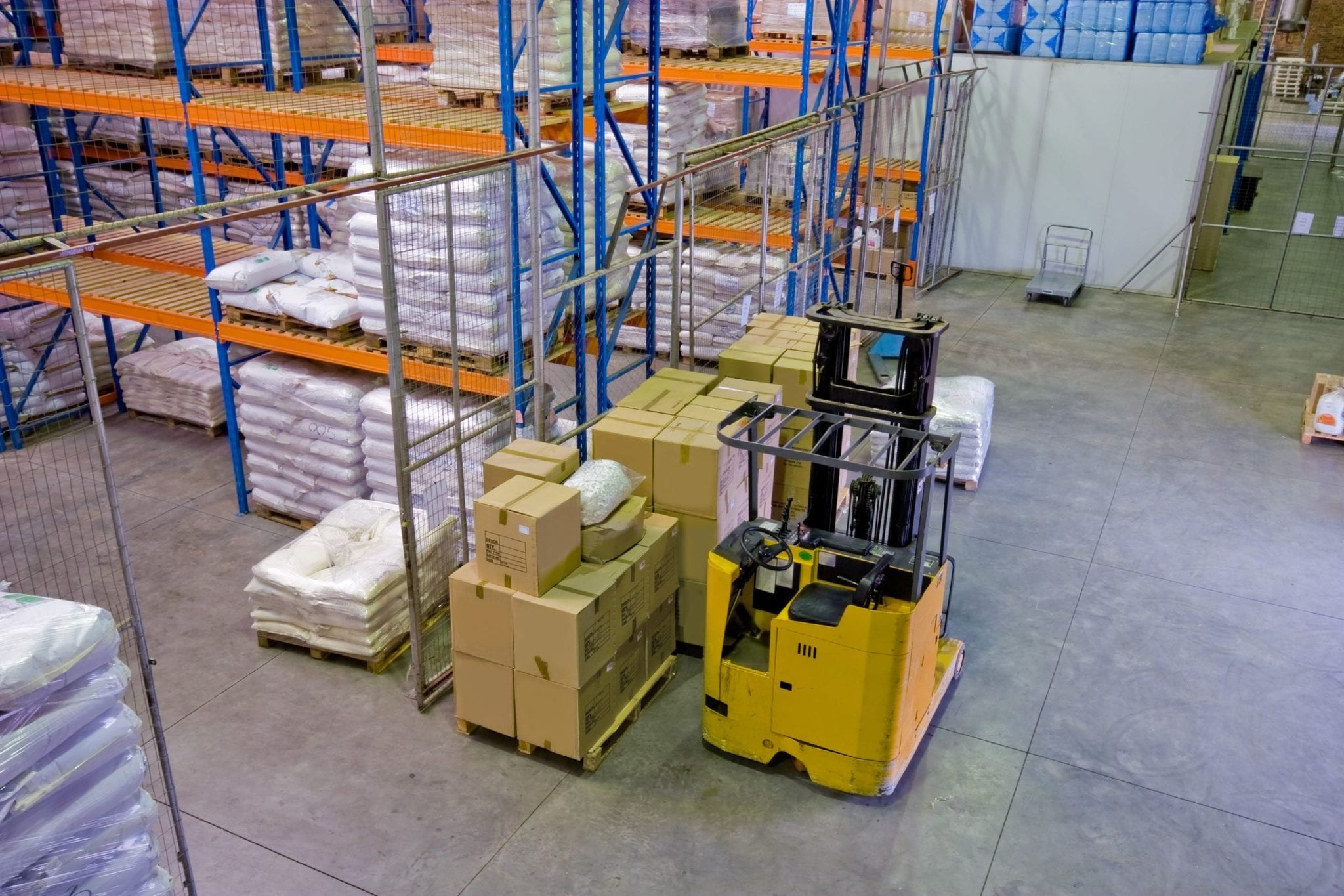 Forklift Parked In Warehouse Stock Photo
