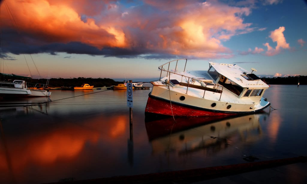 Single Boat Docked At A Marina Stock Photo