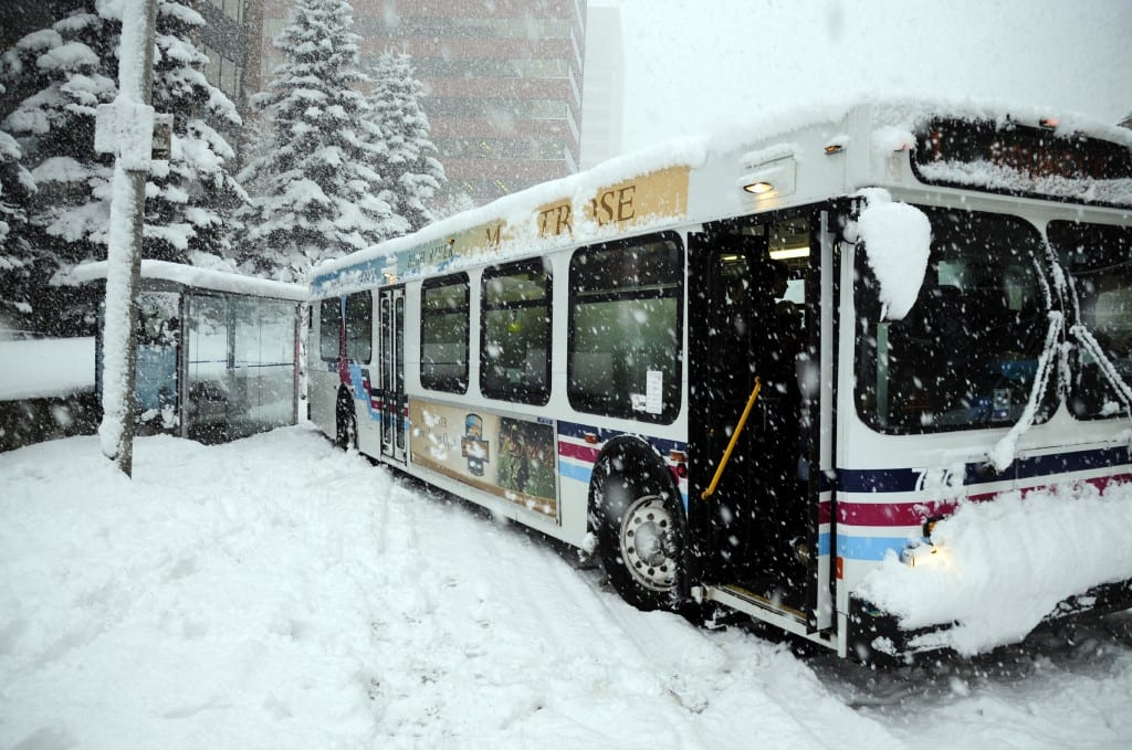 Metro Bus Driving In Snowstorm Stock Photo