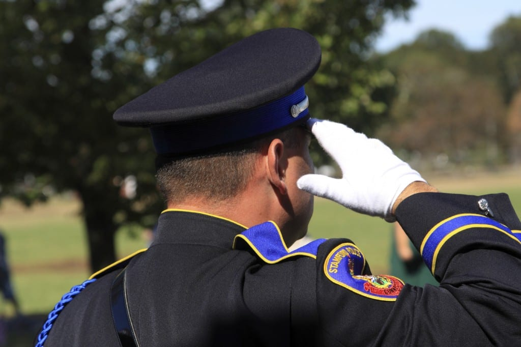 Police Officer Making A Salute At A Ceremony Stock Photo