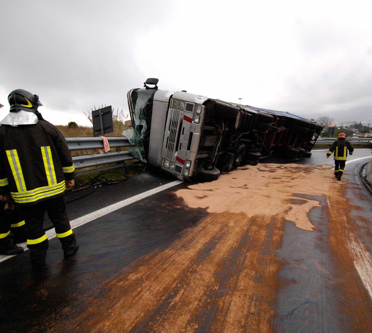 Bus wreck on side crushed in guardrail compressed