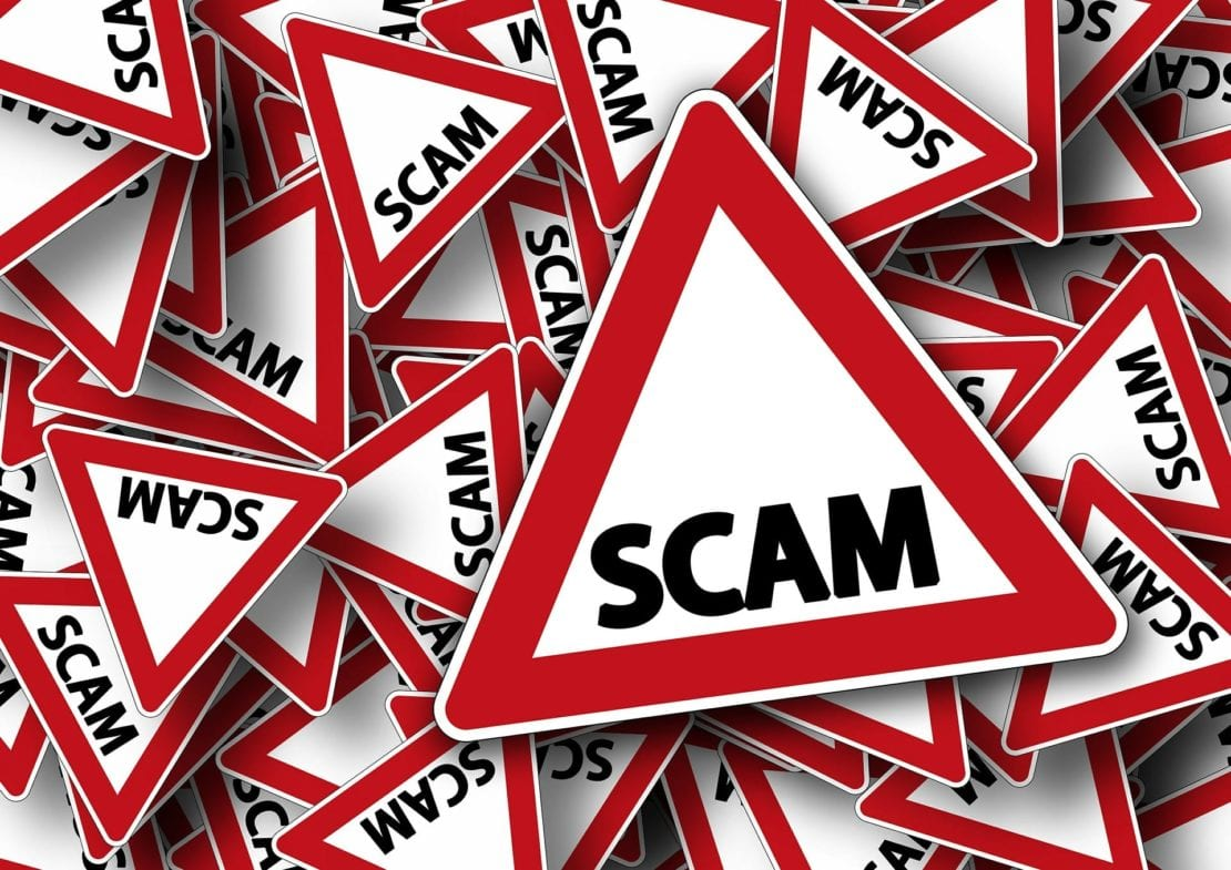 Scam Warning Stock Photo