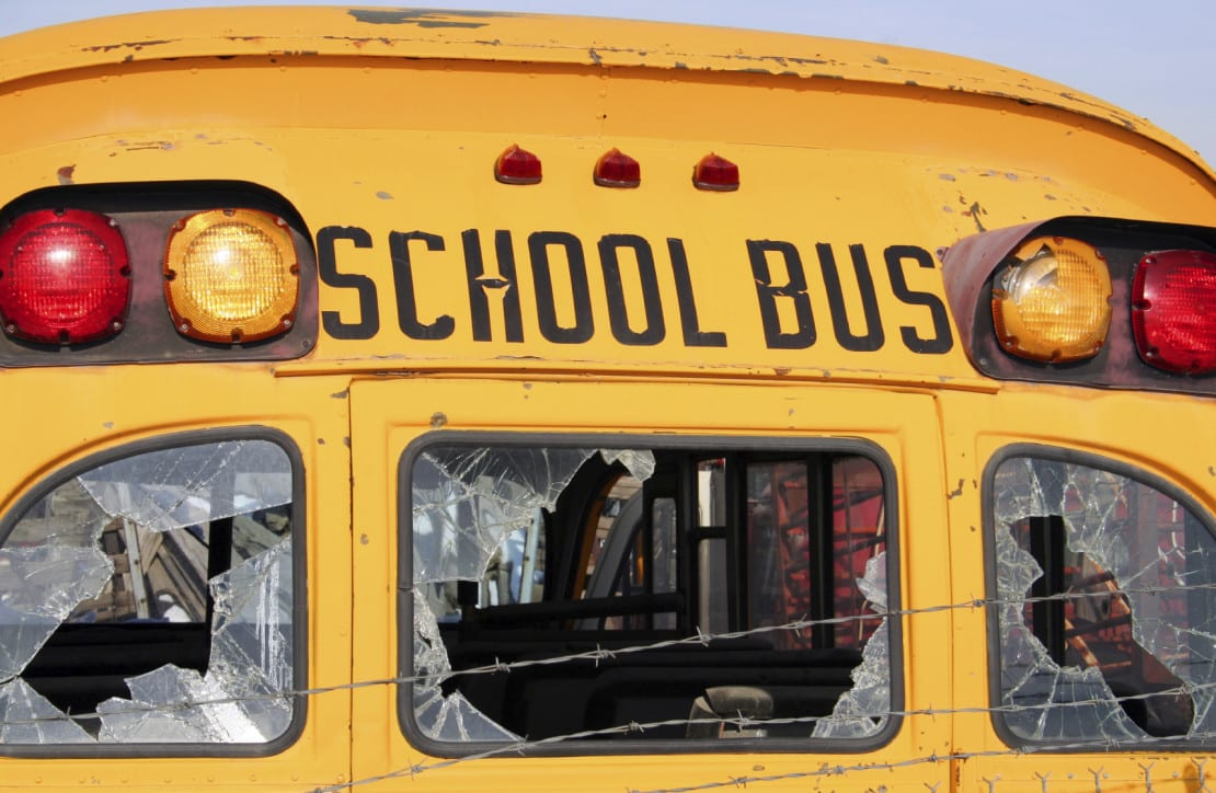 Severely Damaged School Bus Stock Photo