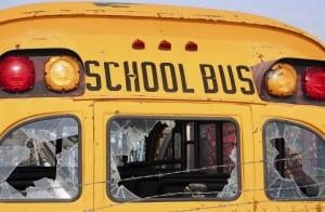 Severely Damaged School Bus Stock Photo