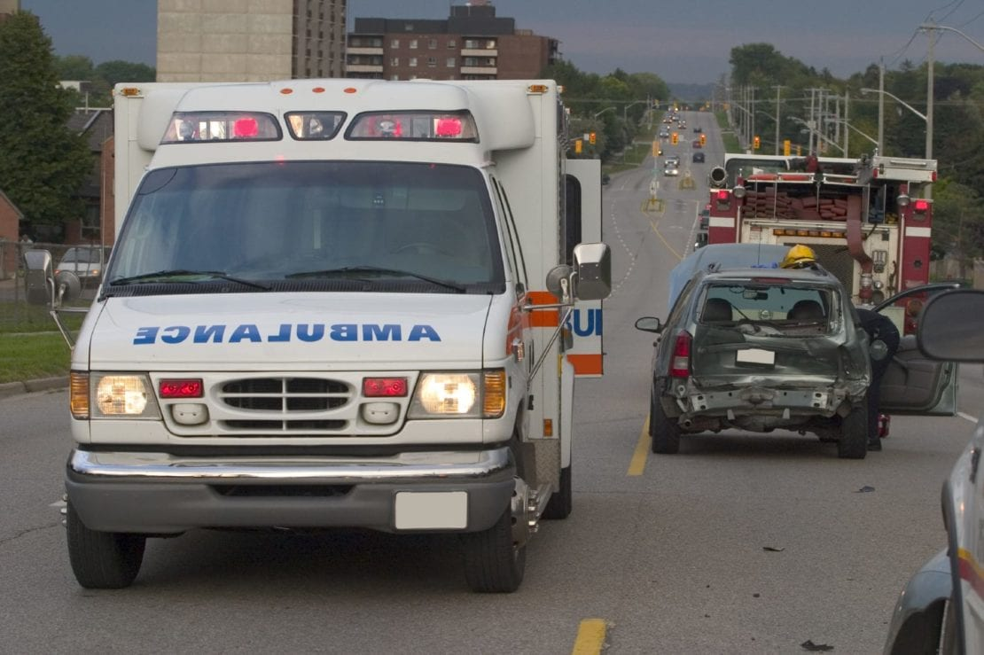 Ambulance At Scene Of Auto Accident Stock Photo