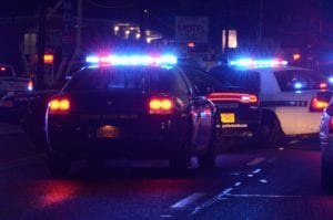 Police Cruisers Responding To An Auto Accident Stock Photo