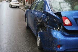 Blue Car With Severe Side Damage Stock Photo