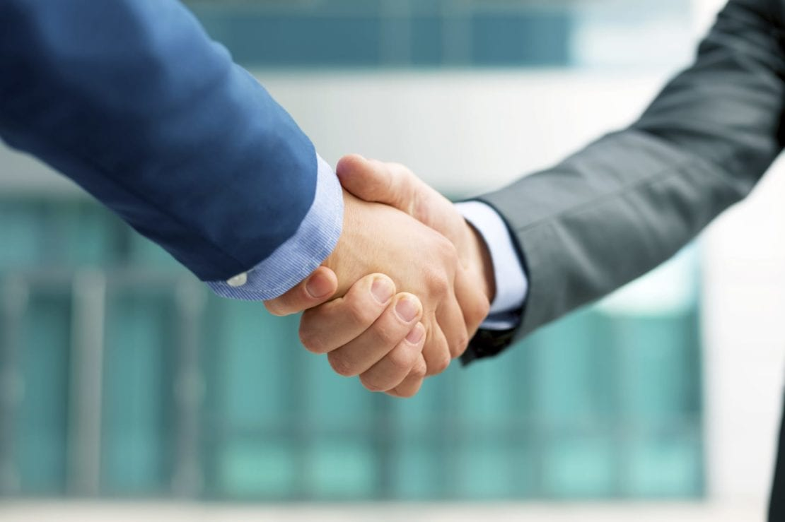 Car Accident Lawyer Shaking Hands With A New Client Stock Photo