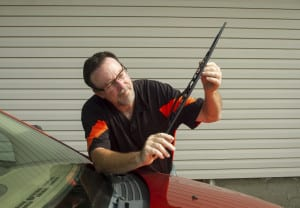 Mechanic Replacing Windshield Wipers On Car Stock Photo