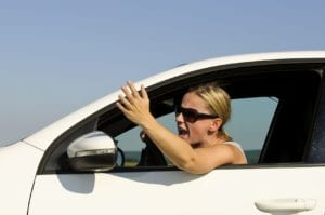 Young Woman Yelling At Another Driver From Her Vehicle Stock Photo