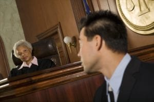 Witness Speaking With A Judge Inside A Courtroom Stock Photo