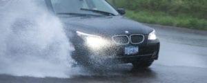Black BMW Driving During Heavy Rainfall