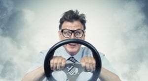 Goofy Looking Man Gripping Steering Wheel Stock Photo