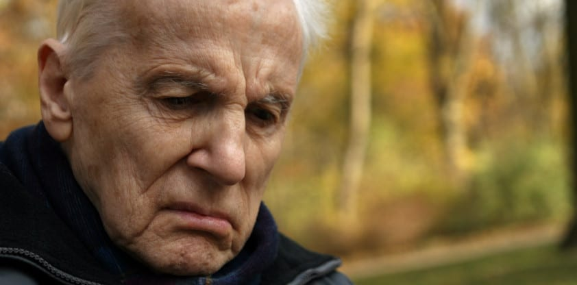 Distressed Elderly Gentleman Walking Outdoors Stock Photo