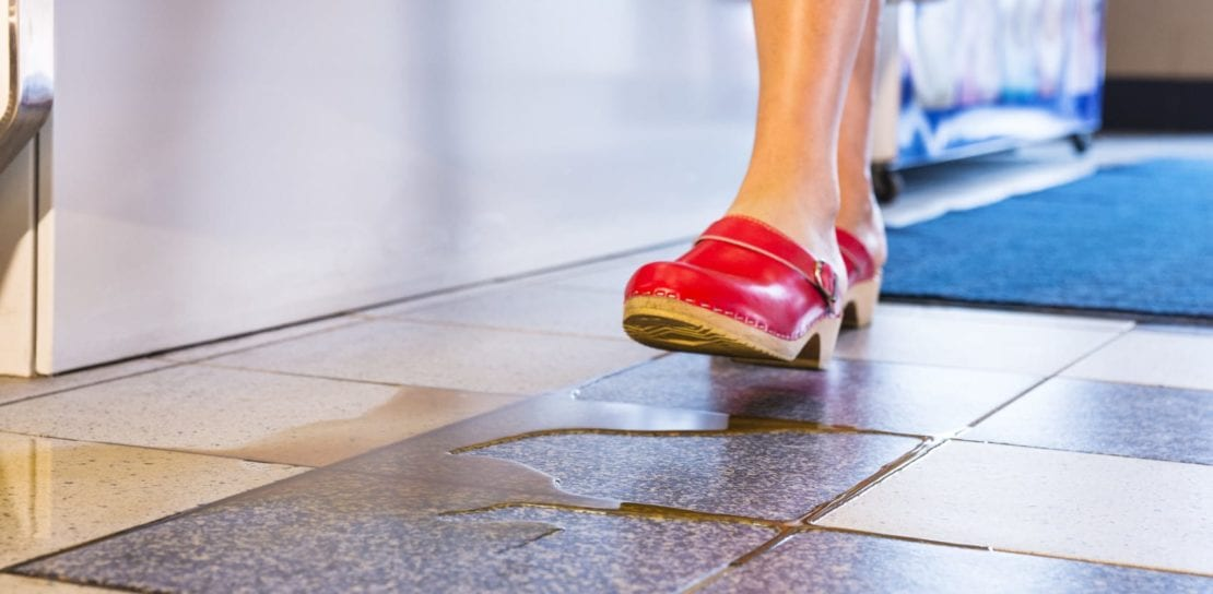 Woman Walking On Wet Floor Stock Photo