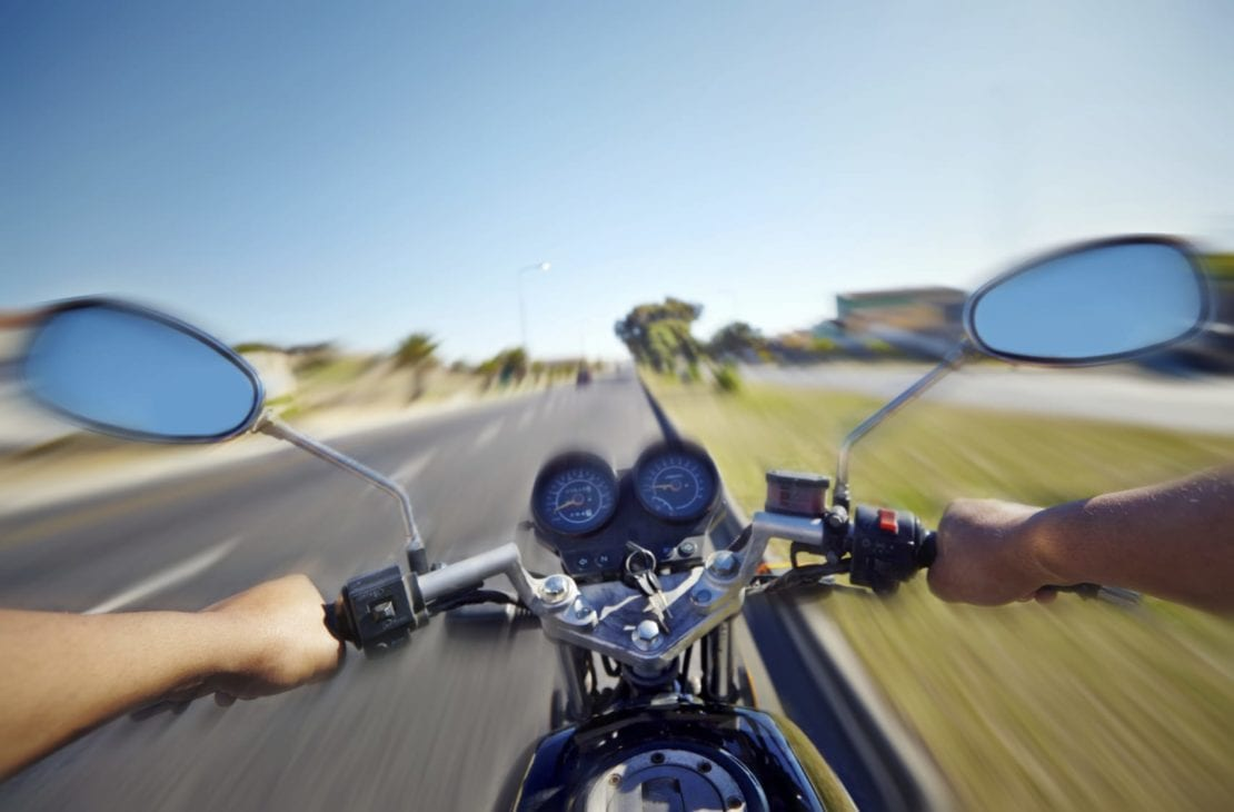 Man Riding His Motorcycle On A Sunny Day Stock Photo