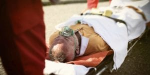 Injured Elderly Man Laying On A Stretcher Stock Photo