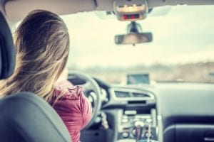 Young Woman Driving On The Highway Stock Photo