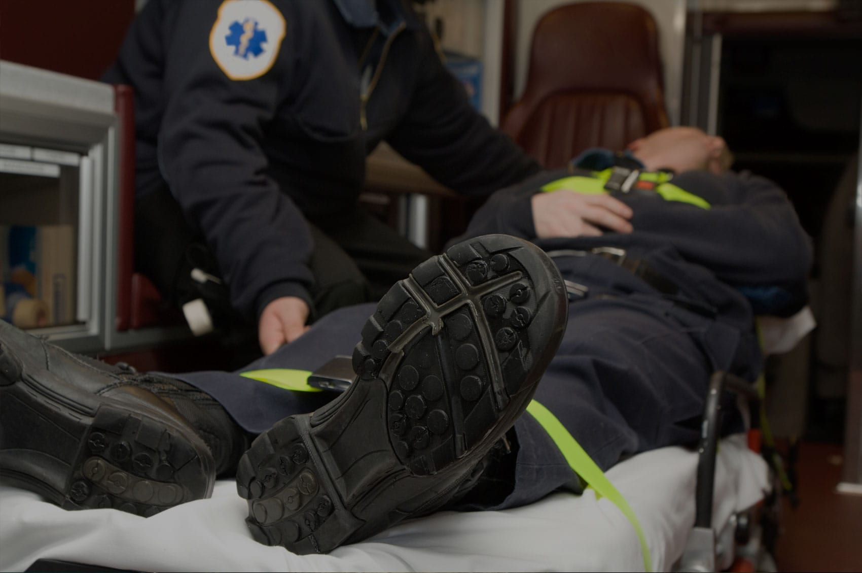 Injured Worker Laying On A Stretcher Stock Photo