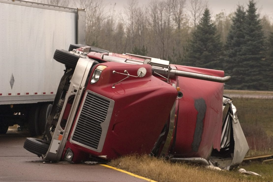 Red 18-wheeler Truck Accident Stock Photo