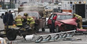 First Responders Helping Car Accident Victims Stock Photo