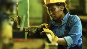 Female Worker In Hard Hat Stock Photo