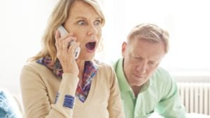 Mature Woman Talking On The Phone Stock Photo