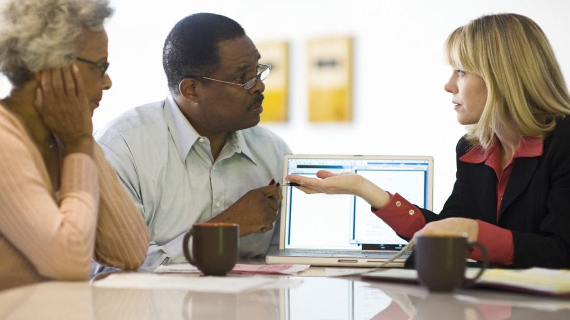 Social Security Lawyer Meeting With Couple Stock Photo