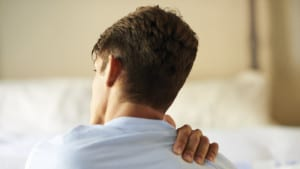 Young Man With Injured Shoulder Stock Photo