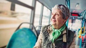 Elderly Woman Riding A City Bus Stock Photo