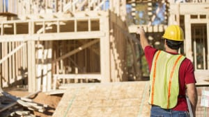 Construction Worker Working On A Home Site Stock Photo