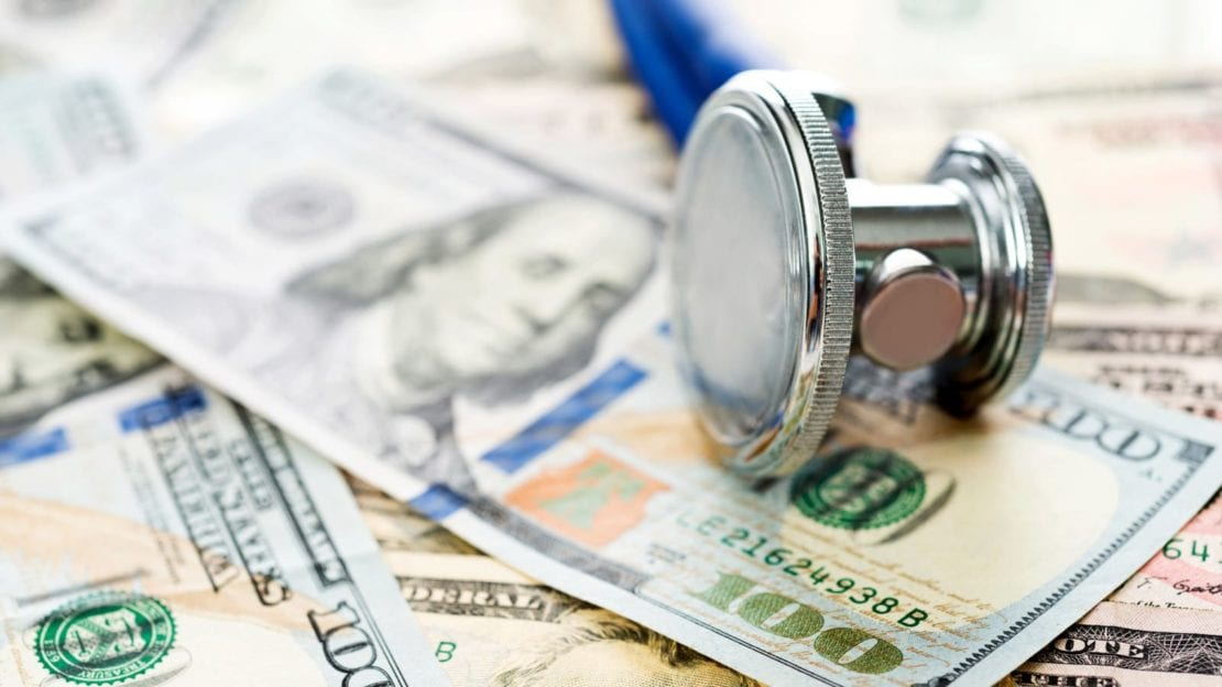 Stethoscope Laying On Top Of $100 Bills Stock Photo