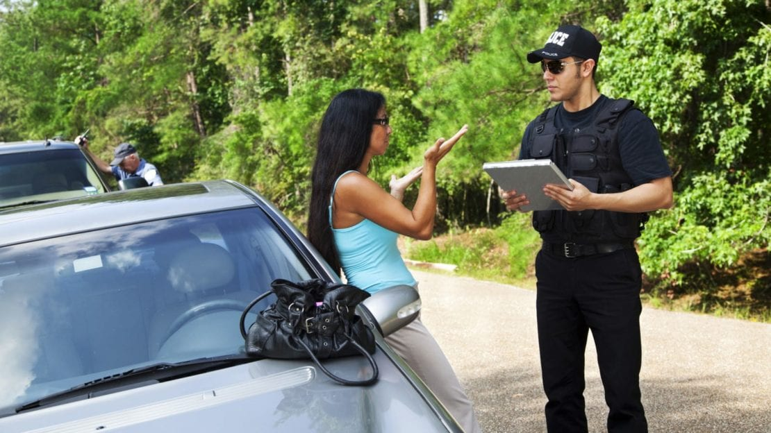 Woman Helping Police Officer Complete Police Report Stock Photo