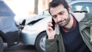 Male Driver Reporting A Car Accident Stock Photo