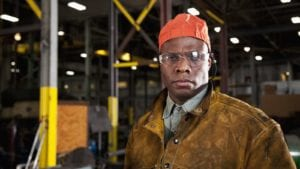 Factory Worker Inside A Fabrication Shop Stock Photo
