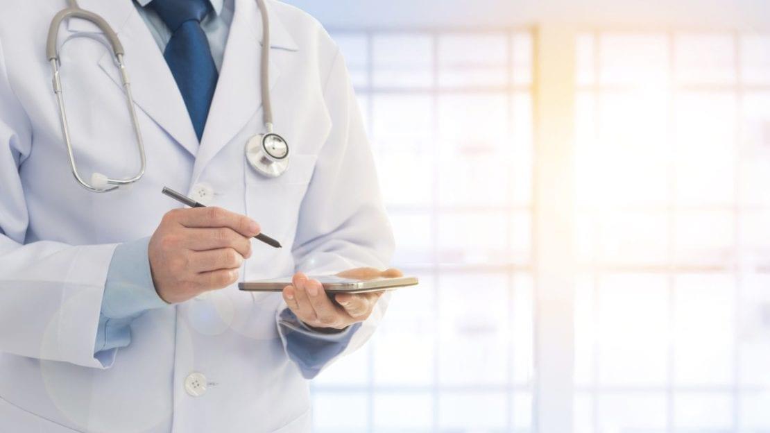 Doctor Writing A Prescription Stock Photo