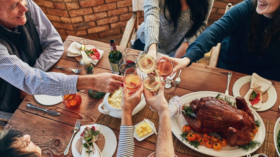 Family Making A Toast At Thanksgiving Stock Photo