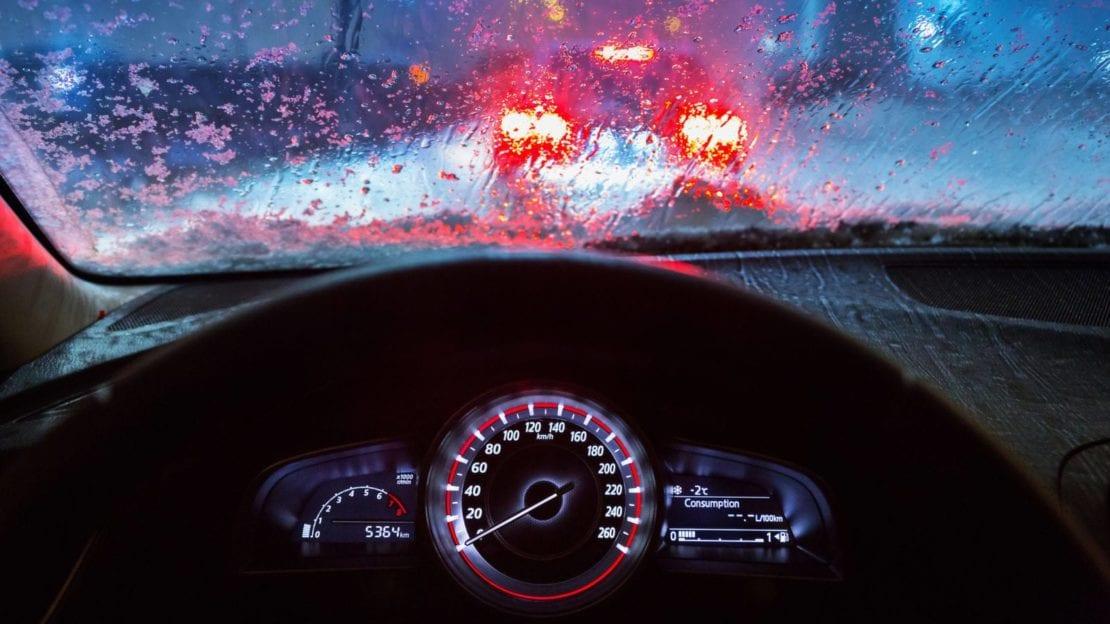 Man Driving His Car At Night During Rainfall Stock Photo