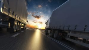 18-wheeler Trucks Driving On The Interstate Stock Photo