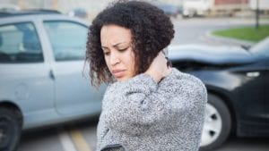 Young Woman Experiencing Neck Pain After A Car Accident Stock Photo
