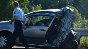 Police Helping Out At Car Accident Scene Stock Photo