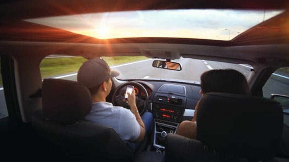 Couple Texting While Driving Stock Photo